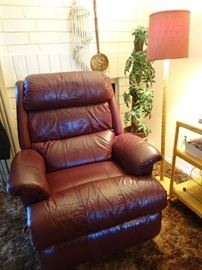 This chair is perfect, the discoloration is just a reflection.  A deep burgundy color, no damage....soooo comfy!