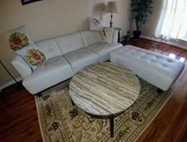 marble top coffee table, pleather sofa and chaise