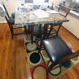 """marble"" top kitchen table with bar height chairs"