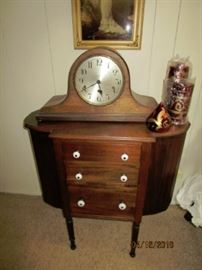 Antique chest table with antique clock