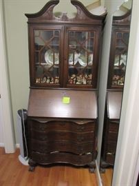 Lovely ox bow front Mahogany drop front desk.  Full of Hummels, very old.