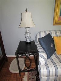 Mahogany and iron side table with porcelain table lamp