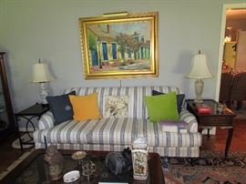 Broyhill custom stripe sofa, pillow decor, Porcelain and crystal table lamps, Mahogany tea table, Iron and Mahogany side table.  Frederick Guess / New Orleans original painiting.