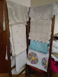 We have lace tablecloths , quilts, chenille bedspreads, table runners