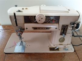 Singer sewing machine in cabinet    Buy it now online 75.00