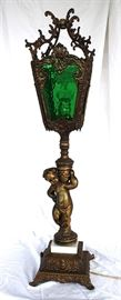 Antique lamp with cherub and green glass shade