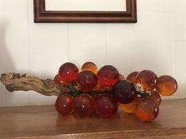 RED AND YELLOW GLASS GRAPES ON STEM