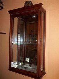 mirrored wall curio cabinet