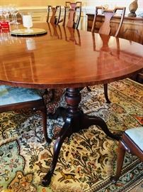 Vintage Heritage dining table with two leaves and 8 chairs