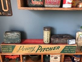 Penny Pitcher game, Metropolitan Life Ins. Co. tin, Edgeworth Extra High Grade Plug Sluce tobacco tin, National Mazda Automotive Lamps tin, Ramon's tin, Revelation Smoking Mixture tin, Steero Bouillon Cubes tin.