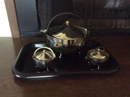 Sleek chrome tea set