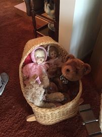 hand made doll bassinet and we have lots of dolls