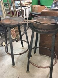 Vintage industrial stools and cast iron skillets.