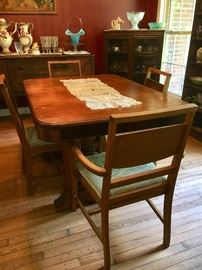 Vintage 1940s walnut dining room group includes table and 5 chairs, buffet and china cabinet. (Veneer is loose on buffet.)