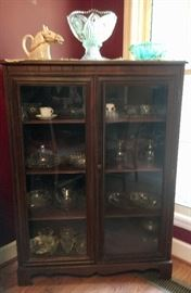 Vintage walnut china cabinet. (Not part of the dining group, but looks good with it.)