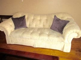 wonderful cream  colored sofa, interesting design and shape.