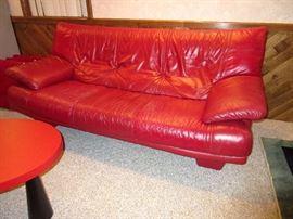 Red Italian leather sofa, delightful