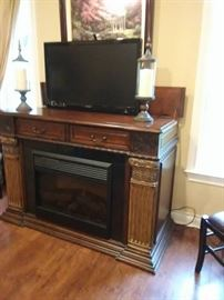 Remote control media center with fireplace insert. Very nice!!TV is not included.