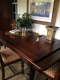 Gorgeous antique draw-leaf table with 10 chairs