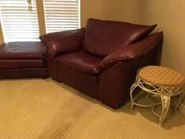 Contemporary leather chair with matching ottoman