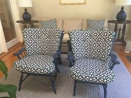 Vintage arm chairs...restored in blue with newly upholstered cushions in indigo blue  retro fabric.