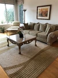 Marble topped coffee table, Bergere chair, sofa and wool rug
