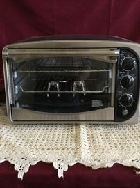 GE Rotisserie Convection Oven & Foodsaver   https://www.ctbids.com/#!/description/share/14372