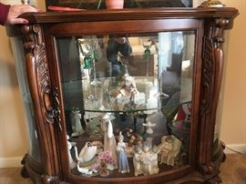 This is a wonderful curio with oval base and walnut tones -- a beautiful piece to display favorites from any collection.