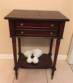 This is a very nice petite table with cute doves.