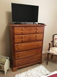 This chest of drawers matches the nightstands -- everything in this sale is extremely well cared for.  That wood and upholstered chair has been trying to sneak in the last couple of photos!