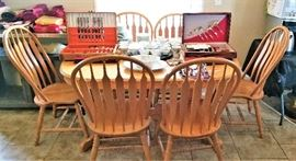 Oak Dining table with 6 chairs and built in leaf. $400