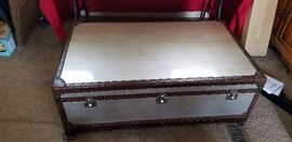 Chest Style coffee table with drawers on each end.