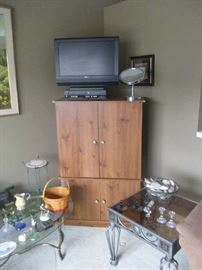 Entertainment center, flat screen TV and glass top tables