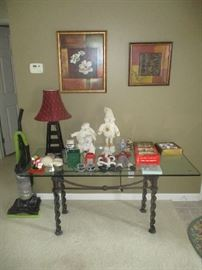 Glass top sofa table household items and lamp