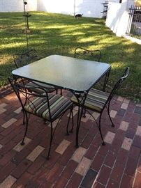 Wrought iron vine pattern table, chairs