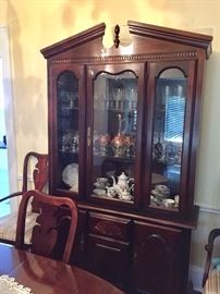 China cabinet, dining table.  Contents will be changed.