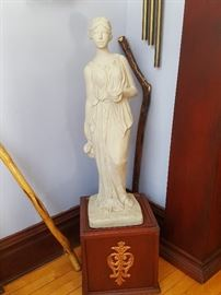 Ceramic statue and walking canes
