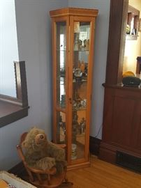 Corner curio cabinet with mirrored backs, glass shelves.