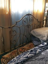 Antique style queen sized bed - metal headboard