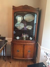 China cabinet with gold accents on glass doors