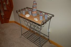 Wrought iron table with wine rack
