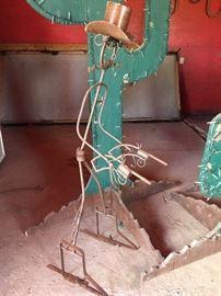 Metal gun slinger sculpture figure