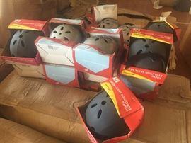 hundreds of skate board helmets