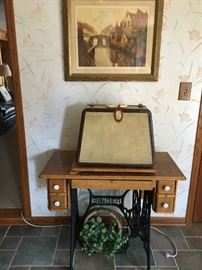 Vintage Treadle Singer Sewing Machine cabinet. The Cased sewing machine is a Singer Featherweight 301W