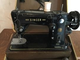 Cased sewing machine is a Singer Featherweight 301W