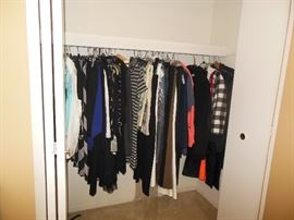 Lots of designer clothes , purses and shoes