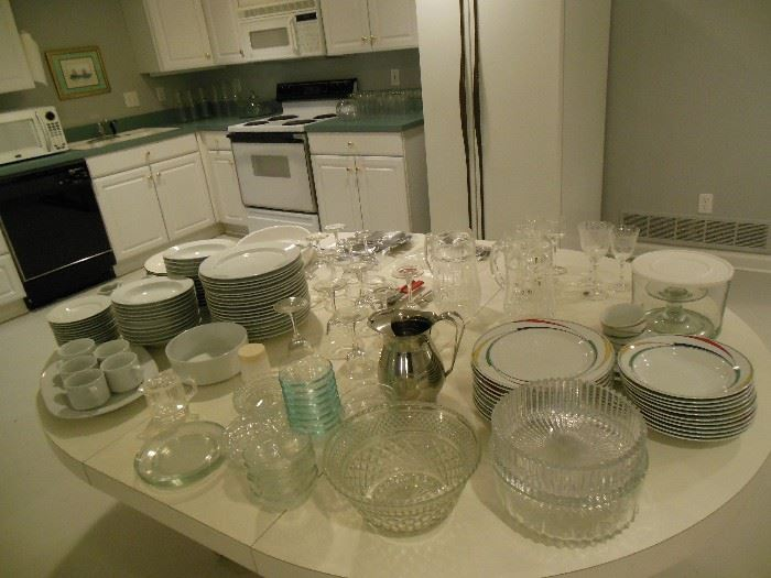 Lots of glassware, plates, and serving ware