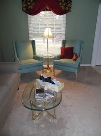 Nice Thomasville wing back chairs and glass tables