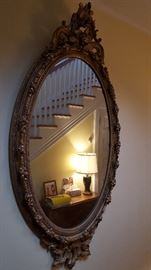 Large-scale antique mirror -- has been restored. Appropriate for a grand entry, high ceilings. Will add measurements to this photo early this week.