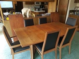 "Mid century dining table and chairs with 2 leafs by Foster McDavid. 42 x 72 as pictured. 2 - 20"" leafs. Table naturally faded. Leafs are darker being stored away from sunlight"